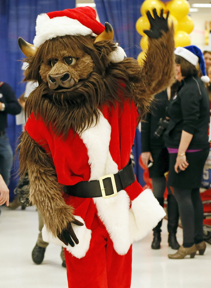 Rumble the Bison waves during the Oklahoma City Thunder's annual Holiday Assist shopping spree at Target, 13924 N Pennsylvania, in Oklahoma City, Monday, Dec. 10, 2012. The ten families who participated in this year's shopping spree are from Sunbeam Family Services' Grandparents Raising Grandchildren program. Photo by Nate Billings, The Oklahoman