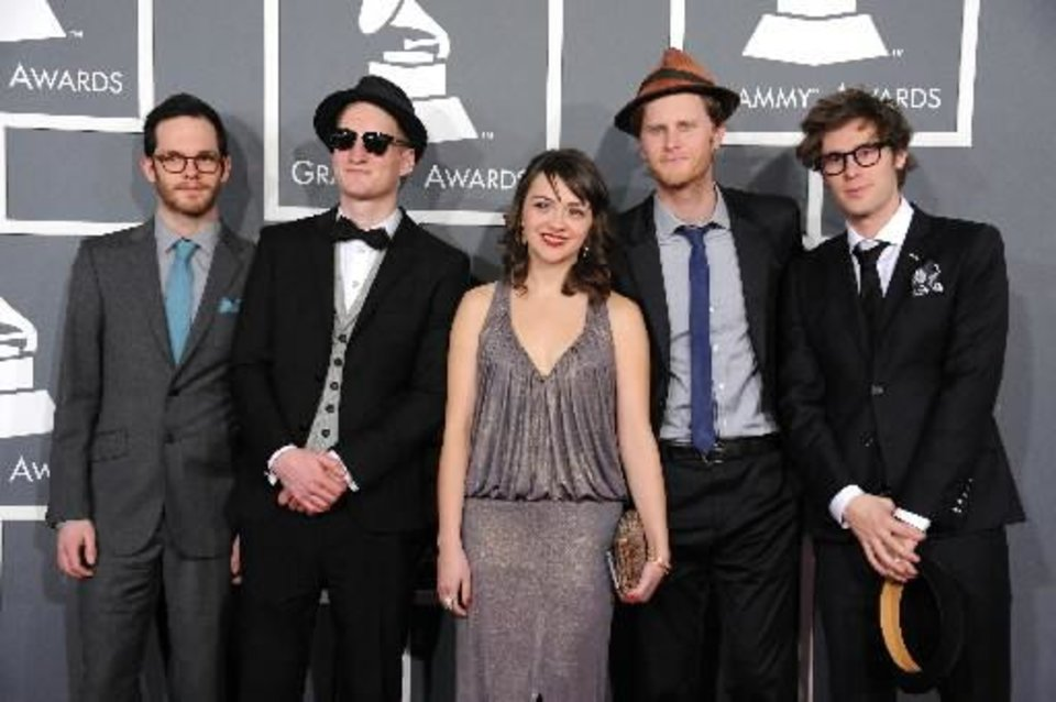 "From left, Ben Wahamaki, Jeremiah Fraites, Neyla Pekarek, Wesley Schultz and Stelth Ulvang, of the musical group ""The Lumineers,"" arrive at the 55th annual Grammy Awards on Sunday, Feb. 10, 2013, in Los Angeles. (AP)"