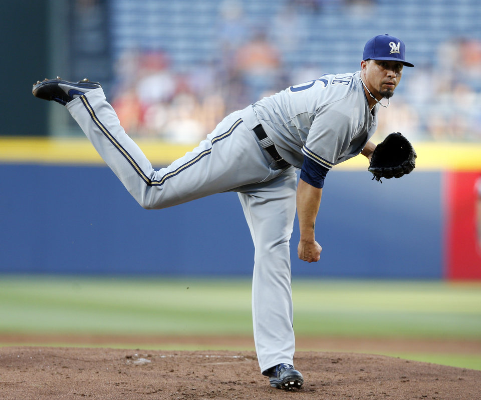 Photo - Milwaukee Brewers starting pitcher Kyle Lohse (26) works in the first inning of a baseball game against Atlanta Braves Wednesday, May 21, 2014, in Atlanta. (AP Photo/John Bazemore)