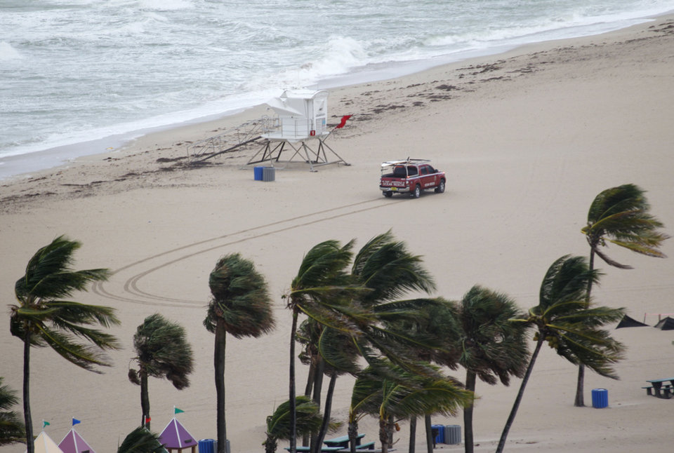 Photo -   A Fort Lauderdale Ocean Rescue truck drives past a lifeguard stand on an empty beach, Thursday, Oct. 25, 2012 in Fort Lauderdale, Fla. Hurricane Sandy was expected to churn through the central and northwest Bahamas late Thursday and early Friday. It also might bring tropical storm conditions along the southeastern Florida coast, the Upper Keys and Florida Bay by Friday morning. (AP Photo/Wilfredo Lee)