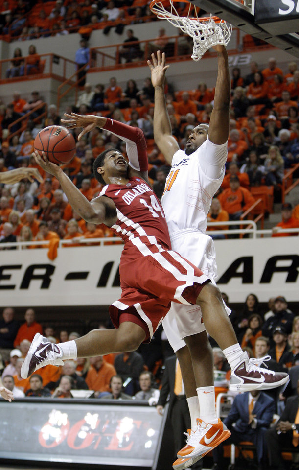 Photo - Oklahoma's Carl Blair Jr. (14) shoots as Oklahoma State's Matt Pilgrim (31) defends during the Bedlam men's college basketball game between the University of Oklahoma Sooners and Oklahoma State University Cowboys at Gallagher-Iba Arena in Stillwater, Okla., Saturday, February, 5, 2011. Photo by Sarah Phipps, The Oklahoman
