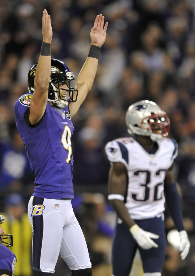 Photo -   Baltimore Ravens kicker Justin Tucker (9) reacts in front of New England Patriots cornerback Devin McCourty after kicking the game-winning field goal in the final moments of an NFL football game in Baltimore, Sunday, Sept. 23, 2012. Baltimore won 31-30. (AP Photo/Gail Burton)