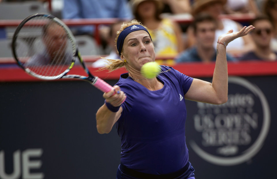 Photo - Anastasia Pavlyuchenkova, of Russia, makes a return to Venus Williams in a first round match at the Rogers Cup tennis tournament in Montreal on Tuesday, Aug. 5, 2014. (AP Photo/The Canadian Press, Paul Chiasson)