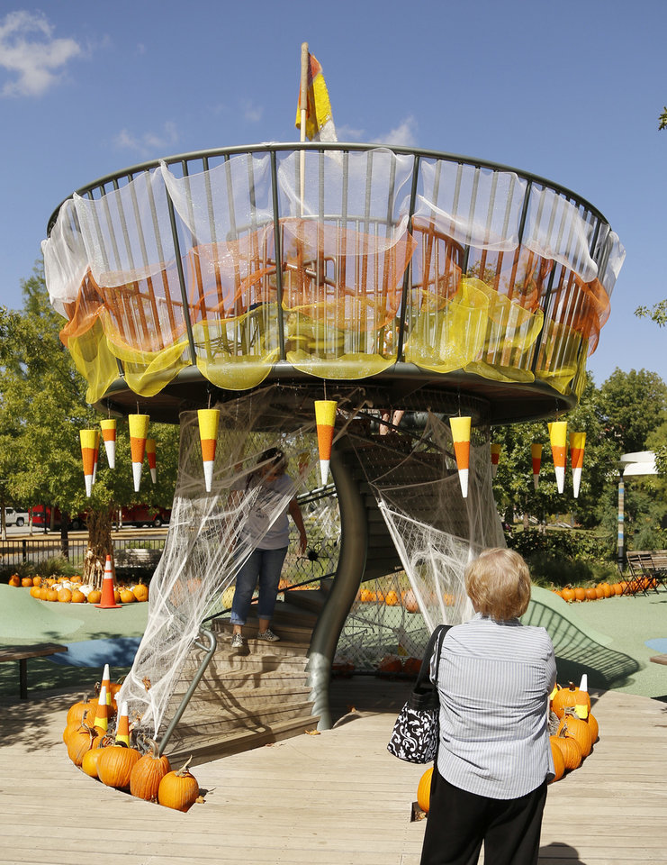 Photo - The tower is decorated like a giant piece of candy corn in the Pumpkinville exhibit at the Myriad Botanical Gardens. PHOTO BY DOUG HOKE, THE OKLAHOMAN  DOUG HOKE - THE OKLAHOMAN