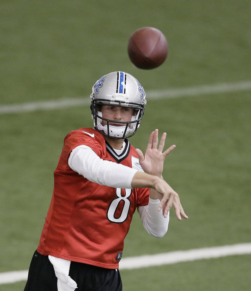 Photo - Detroit Lions quarterback Dan Orlovsky runs through drills at the Lions training facility in Allen Park, Mich., Tuesday, April 22, 2014. (AP Photo/Carlos Osorio)