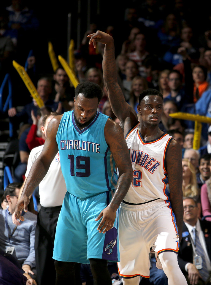 Photo - Oklahoma City's Anthony Morrow (2) celebrates a 3-point basket in front of Charlotte's P.J. Hairston (19) during the NBA basketball game between the Oklahoma City Thunder and the Charlotte Hornets at the Chesapeake Energy Arena in Oklahoma City, Friday, Dec. 26, 2014. Photo by Sarah Phipps, The Oklahoman