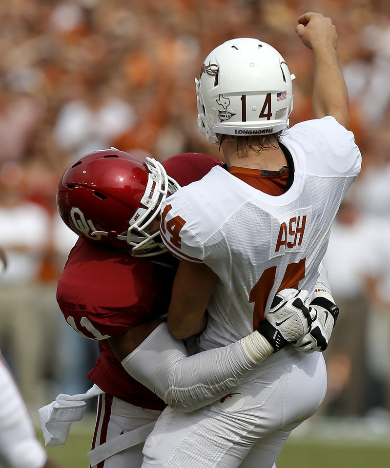 Photo - OU's R.J. Washington (11) hits UT's David Ash (14) during the Red River Rivalry college football game between the University of Oklahoma (OU) and the University of Texas (UT) at the Cotton Bowl in Dallas, Saturday, Oct. 13, 2012. Oklahoma won 63-21. Photo by Bryan Terry, The Oklahoman