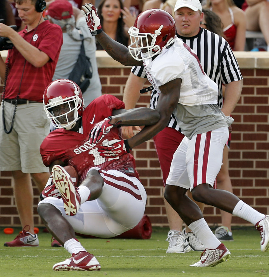 Photo - Dorial Green-Beckham (11) catches a pass during the University of Oklahoma Sooners (OU) practice and Student Day at Gaylord Family-Oklahoma Memorial Stadium in Norman, Okla., on Thursday, Aug. 21, 2014. Photo by Steve Sisney, The Oklahoman