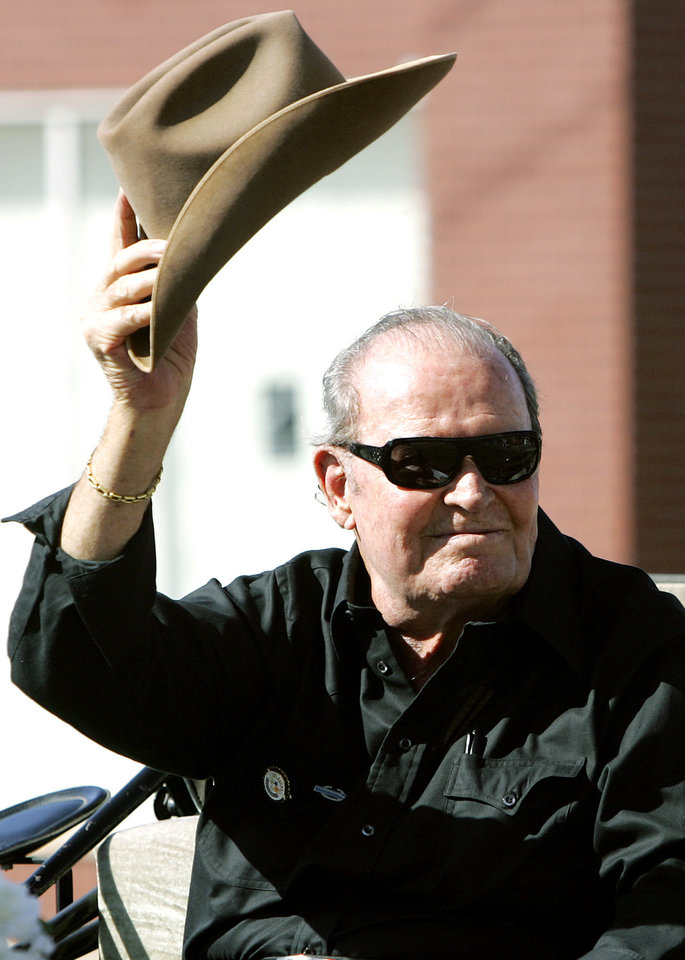 Photo - Actor and Norman native James Garner waves to crowds during the 89er Day Parade in Norman, Okla., Saturday April, 22, 2006.  By John Clanton, The Oklahoman