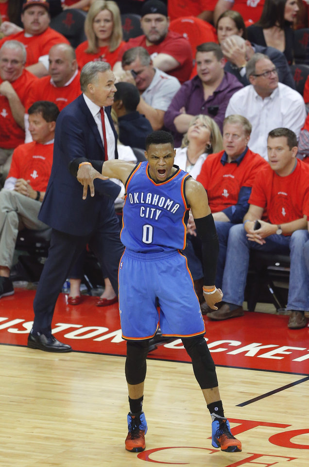 Photo - Oklahoma City's Russell Westbrook (0) celebrates in front of Houston coach Mike D'Antoni after making 3-pointer during Game 5 in the first round of the NBA playoffs between the Oklahoma City Thunder and the Houston Rockets at the Toyota Center in Houston, Texas,  Tuesday, April 25, 2017.  Photo by Sarah Phipps, The Oklahoman