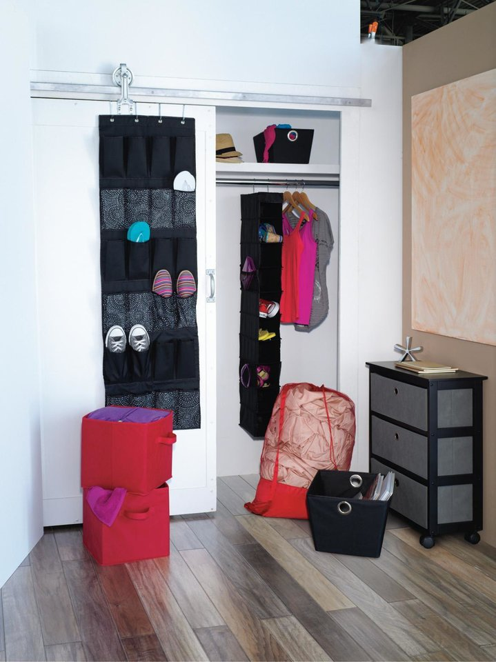 Photo - Shoe holders, hanging shelves, collapsible storage boxes and laundry bags help with organizing. Photo provided.