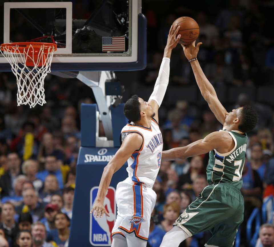 Photo - Oklahoma City's Andre Roberson (21) blocks the shot of Milwaukee's Giannis Antetokounmpo (34) during an NBA basketball game between the Oklahoma City Thunder and the Milwaukee Bucks at Chesapeake Energy Arena in Oklahoma City, Tuesday, April 4, 2017. Photo by Bryan Terry, The Oklahoman