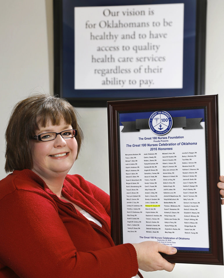 Photo -  Rebekah Gossett, population care management supervisor at the Oklahoma Health Care Authority, was recently named a 2016 Great 100 Nurses honoree for Oklahoma. Gossett was also nominated for the March of Dimes Nurse of the Year award in the public health category. Gossett is shown with her Great 100 Nurses plaque at OHCA offices in Oklahoma City. [Photo by Jim Beckel, The Oklahoman]