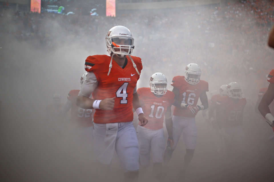 OSU quarterback J.W. Walsh earns high praise as a leader and a winner and will enter the season as the starter. Photo by Sarah Phipps, The Oklahoman Archives