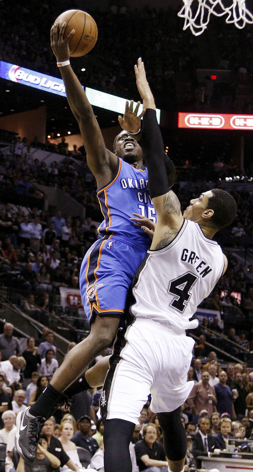 Photo - Oklahoma City's Reggie Jackson (15) lays up the ball against San Antonio's Danny Green (4) during Game 5 of the Western Conference Finals in the NBA playoffs between the Oklahoma City Thunder and the San Antonio Spurs at the AT&T Center in San Antonio, Thursday, May 29, 2014. Photo by Sarah Phipps, The Oklahoman