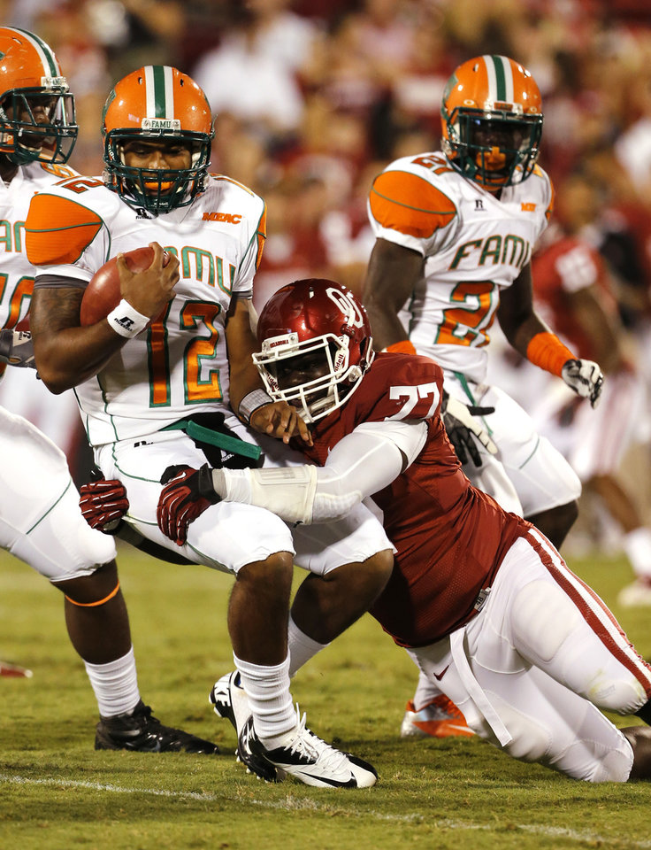 Photo - Marquis Anderson (77) sacks Tyler Bass (12) during the second half of the college football game between the University of Oklahoma Sooners (OU) and Florida A&M Rattlers at Gaylord Family-Oklahoma Memorial Stadium in Norman, Okla., Saturday, Sept. 8, 2012. Photo by Steve Sisney, The Oklahoman