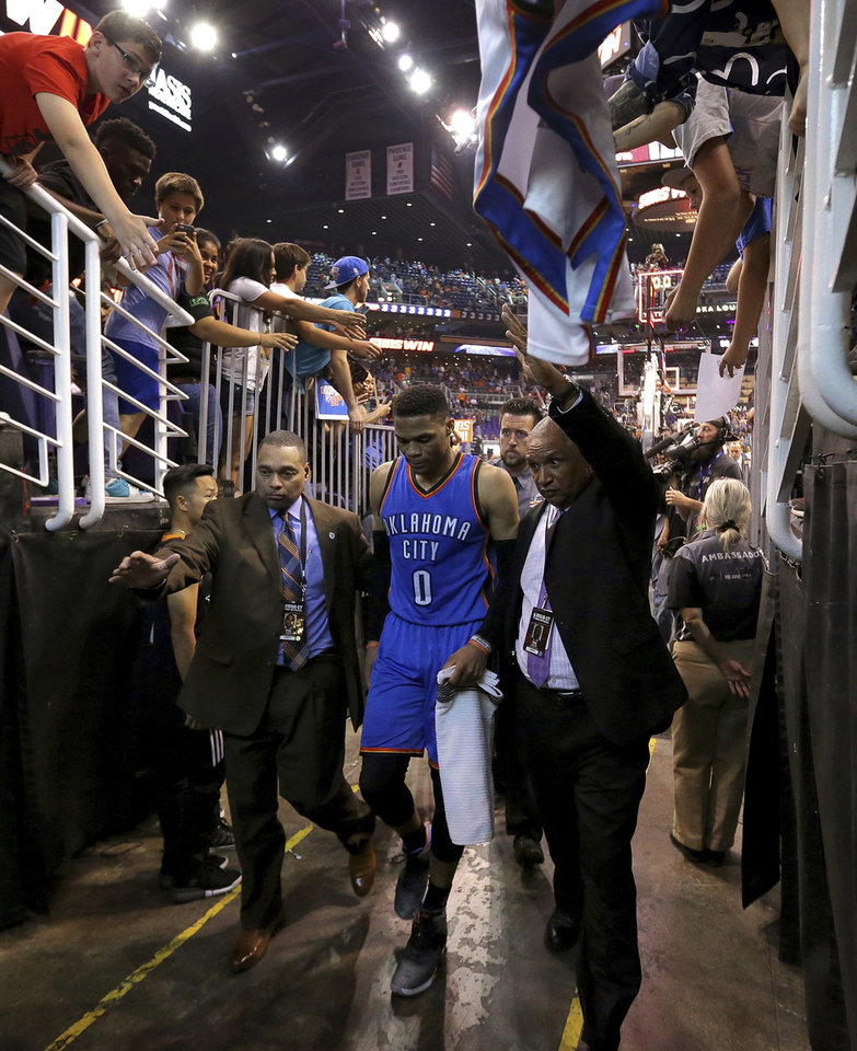 Photo - Oklahoma City Thunder guard Russell Westbrook (0) leaves the court after the team's NBA basketball game against the Phoenix Suns, Friday, April 7, 2017, in Phoenix. The Suns won 120-99. (AP Photo/Matt York)