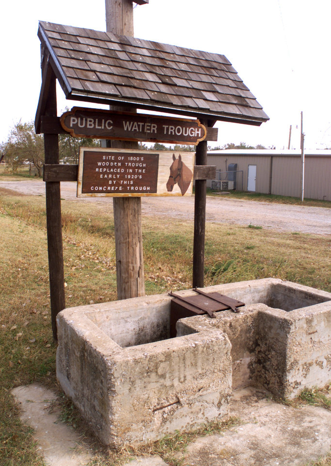 Photo -  The concrete public water trough in Geary served farmers and agricultural tradesmen from 1898 to 1939. It and the well site are on the National Register of Historic Places. [PHOTO BY PAUL HELLSTERN, THE OKLAHOMAN ARCHIVES]