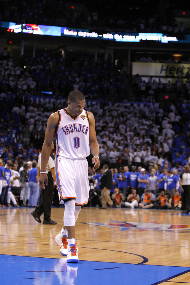 Photo - Oklahoma City's Russell Westbrook (0) walks of the court following Game 2 of the NBA Finals between the Oklahoma City Thunder and the Miami Heat at Chesapeake Energy Arena in Oklahoma City, Thursday, June 14, 2012. Photo by Sarah Phipps, The Oklahoman