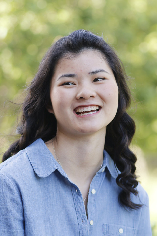 Photo -  Abbey Grace White, 17, who was adopted from a Chinese orphanage, plans to return to China during the summer to help orphans. Photo by Doug Hoke, The Oklahoman   DOUG HOKE