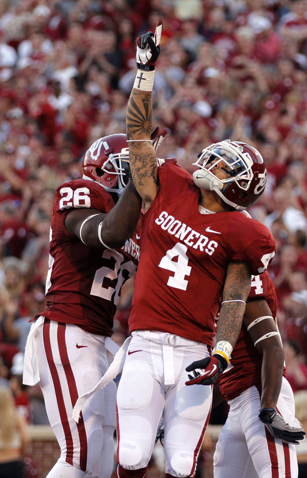 OU\'s Kenny Stills (4) reacts after scoring a touchdown during the college football game between the University of Oklahoma Sooners (OU) and the University of Kansas Jayhawks (KU) at Gaylord Family-Oklahoma Memorial Stadium on Saturday, Oct. 20th, 2012, in Norman, Okla. Photo by Chris Landsberger, The Oklahoman