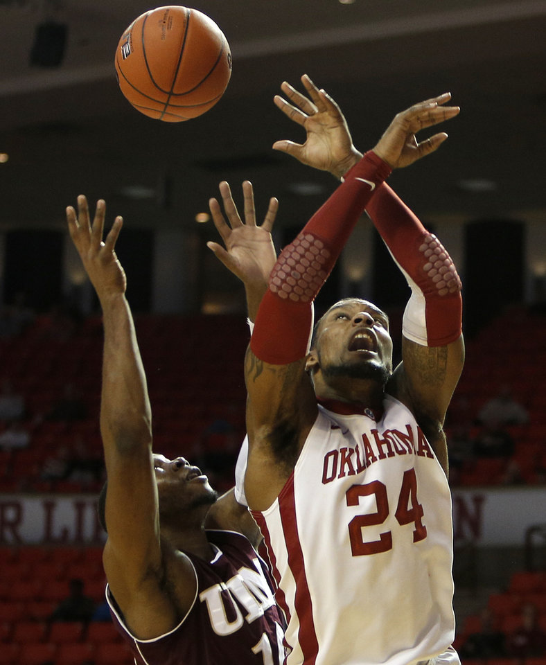 Photo - Oklahoma's Romero Osby (24) and Louisiana's Amos Olatayo (10) go up for a rebound during a men's college basketball game between the University of Oklahoma and the University of Louisiana-Monroe at the Loyd Noble Center in Norman, Okla., Sunday, Nov. 11, 2012.  Photo by Garett Fisbeck, The Oklahoman