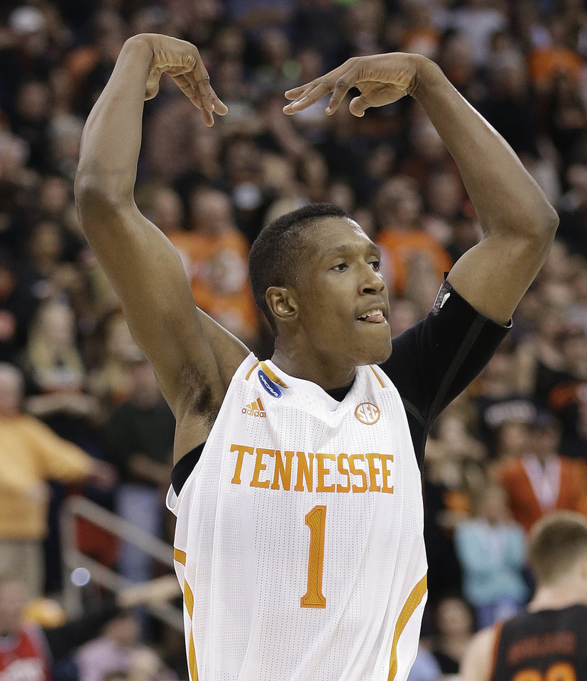 Photo - Tennessee guard Josh Richardson (1) reacts to a goal against Mercer during the first half of an NCAA college basketball third-round tournament game, Sunday, March 23, 2014, in Raleigh. (AP Photo/Gerry Broome)