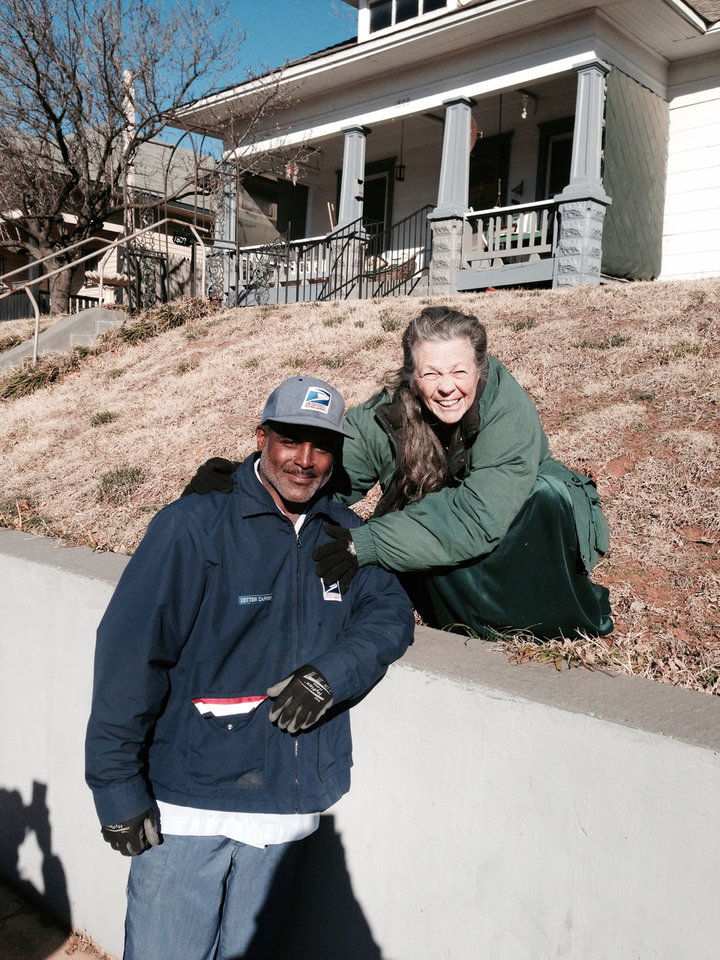 Photo -  Mail carrier Reggie Sloan, 44, is credited with alerting Jerilyn Pender, a resident of the building, about the fire. [Photo Provided]