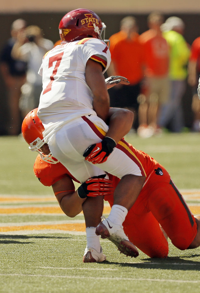 Photo - Oklahoma State's James Castleman (91) knocks down Iowa State quarterback Jared Barnett (7) after pressuring him on a throw during a college football game between Oklahoma State University (OSU) and Iowa State University (ISU) at Boone Pickens Stadium in Stillwater, Okla., Saturday, Oct. 20, 2012. OSU won, 31-10. Photo by Nate Billings, The Oklahoman