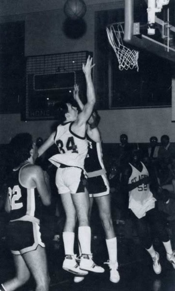 Photo -  Thunder coach Billy Donovan shoots during a varsity game with St. Agnes Cathedral in New York. [Photo provided]