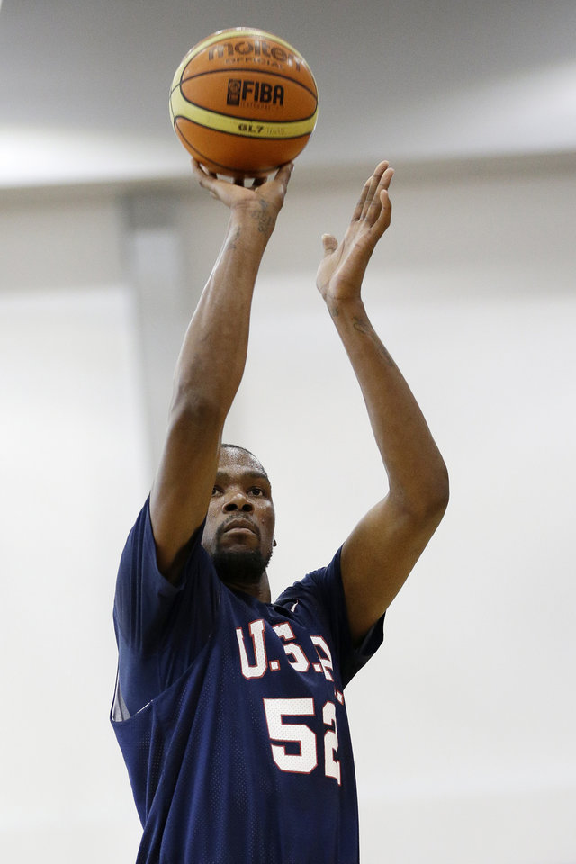 Photo - Oklahoma City Thunder's Kevin Durant (52) shoots a free throw during a USA Basketball minicamp scrimmage Monday, July 28, 2014, in Las Vegas. (AP Photo/John Locher)
