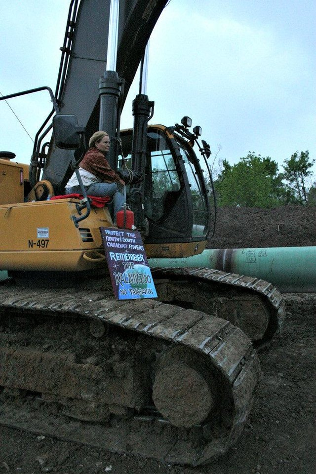 Luther resident Gwen Ingram chained herself to a piece of construction equipment Tuesday in an attempt to block construction of the southern leg of the Keystone XL pipeline. Photo provided