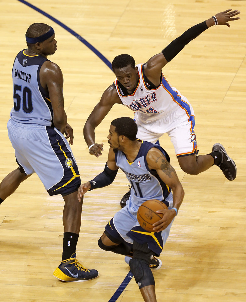 Oklahoma City's Reggie Jackson (15) tries to get around Memphis' Zach Randolph (50) while guarding Mike Conley (11) during Game 5 in the first round of the NBA playoffs between the Oklahoma City Thunder and the Memphis Grizzlies at Chesapeake Energy Arena in Oklahoma City, Tuesday, April 29, 2014. Photo by Nate Billings, The Oklahoman
