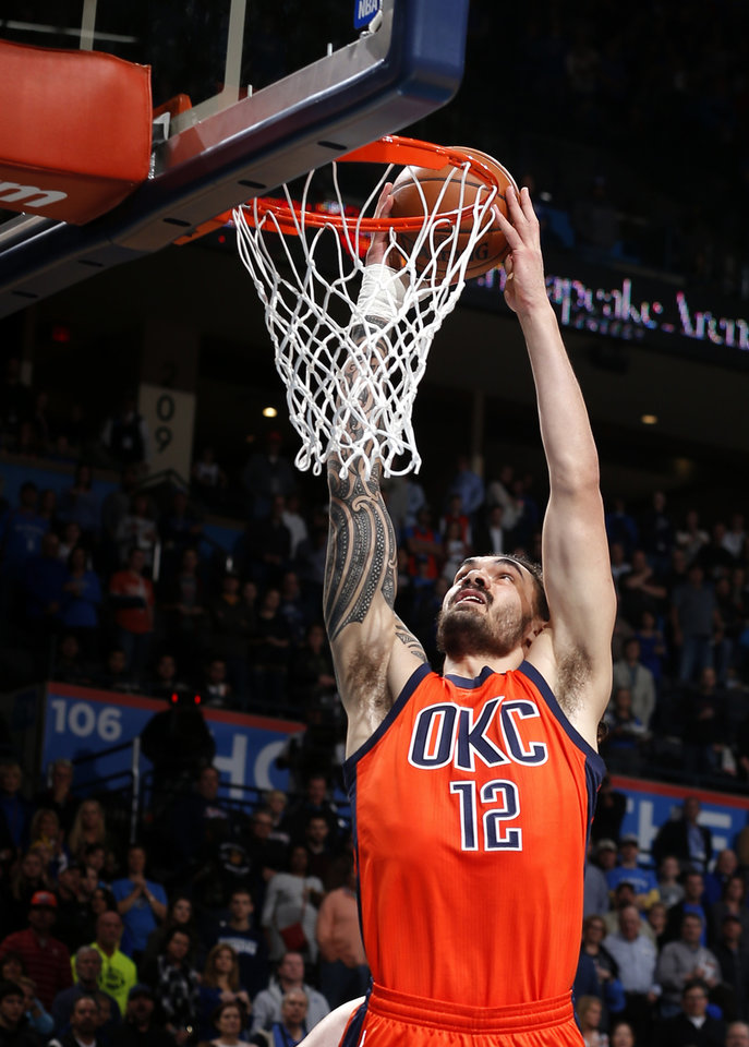 Photo - Oklahoma City's Steven Adams (12) dunks the ball during the NBA game between the Oklahoma City Thunder and the New Orleans Pelicans at the Chesapeake Energy Arena,  Sunday, Dec. 4, 2016. Photo by Sarah Phipps, The Oklahoman