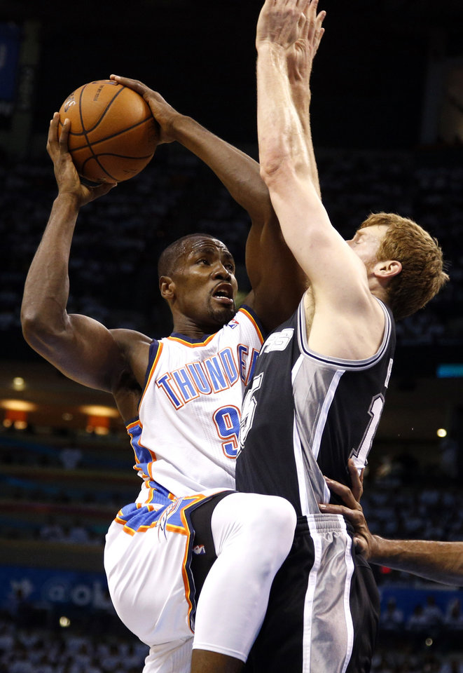 Photo - Oklahoma City's Serge Ibaka (9) drives to the basket as San Antonio's Matt Bonner (15) defends during Game 6 of the Western Conference Finals in the NBA playoffs between the Oklahoma City Thunder and the San Antonio Spurs at Chesapeake Energy Arena in Oklahoma City, Saturday, May 31, 2014. Photo by Bryan Terry, The Oklahoman