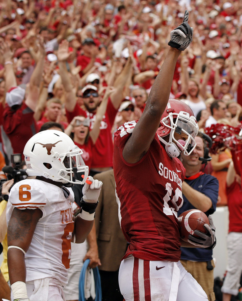 Photo - OU's Justin Brown (19) celebrates a touchdown catch against UT's Quandre Diggs (6)in the fourth quarter during the Red River Rivalry college football game between the University of Oklahoma (OU) and the University of Texas (UT) at the Cotton Bowl in Dallas, Saturday, Oct. 13, 2012. OU won, 63-21. Photo by Nate Billings, The Oklahoman