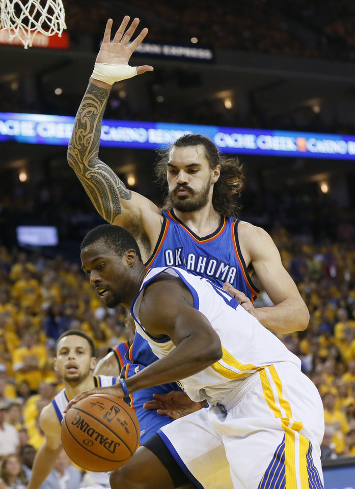 Photo - Oklahoma City's Steven Adams (12) defends Golden State's Harrison Barnes (40) during Game 7 of the Western Conference finals in the NBA playoffs between the Oklahoma City Thunder and the Golden State Warriors at Oracle Arena in Oakland, Calif., Monday, May 30, 2016. Photo by Nate Billings, The Oklahoman