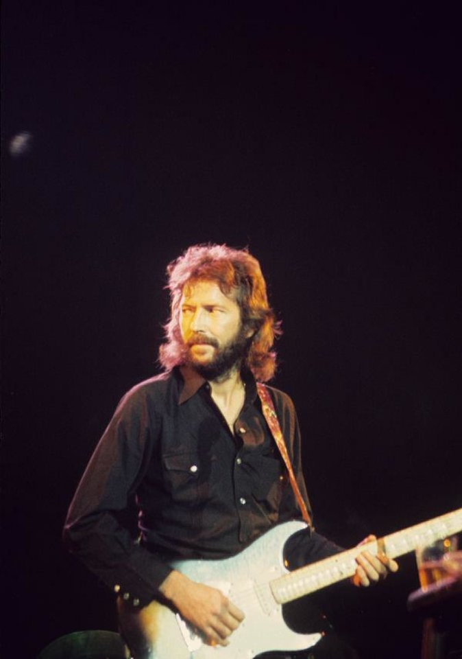 Eric Clapton plays a 1975 concert at the Myriad Convention Center. Three Tulsa musicians - drummer Jamie Oldaker, bassist Carl Radle and keyboardist Dick Sims - played with Clapton at the show and during the 1970s. OKPOP Collection photo <strong></strong>