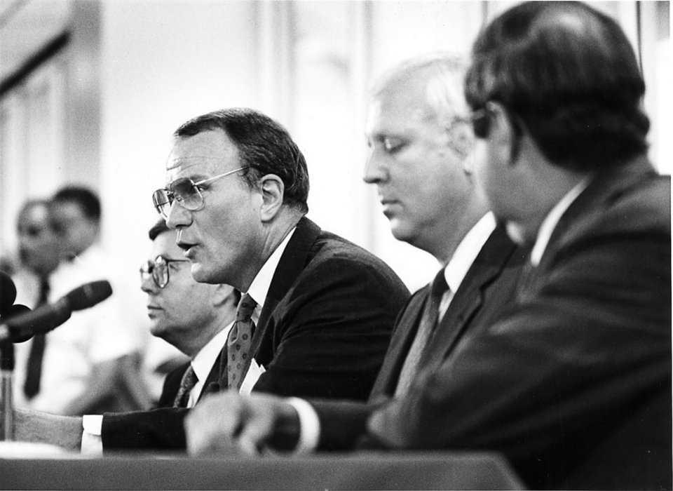 Photo - Barry Switzer announces his resignation during a June 19, 1989 press conference in Norman. PHOTO BY STEVE SISNEY, The Oklahoman Archives