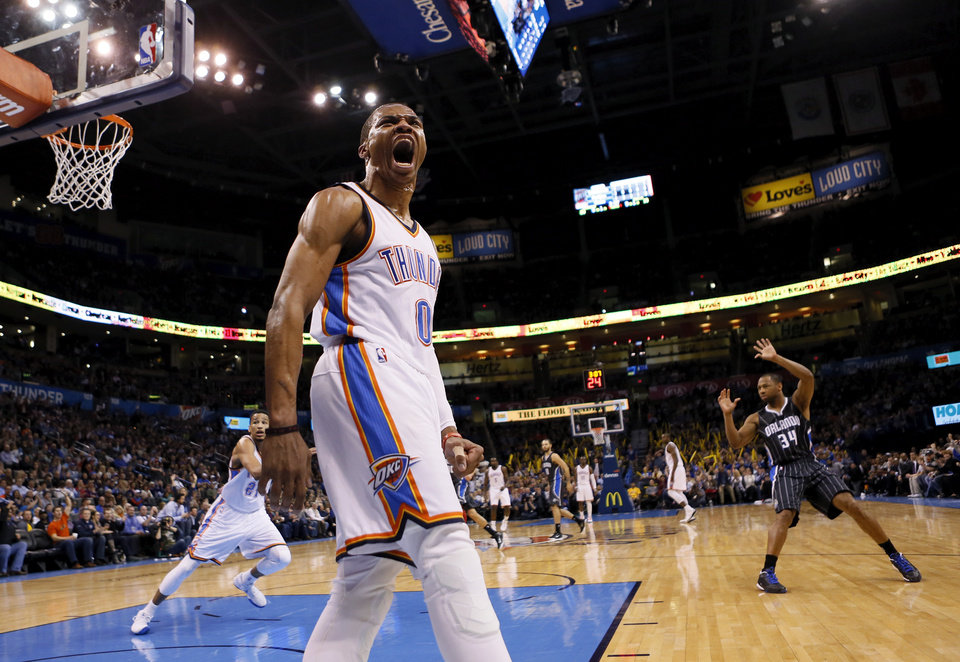 Photo - Oklahoma City's Russell Westbrook (0) reacts after a dunk during an NBA basketball game between the Oklahoma City Thunder and the Orlando Magic at Chesapeake Energy Arena in Oklahoma City, Monday, Feb. 2, 2015. Photo by Nate Billings, The Oklahoman