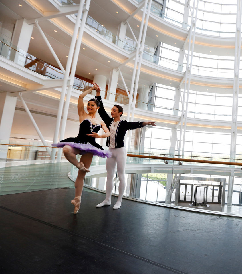 Photo -  Oklahoma City Ballet dancers Miki Kawamura and Alvin Tovstogray perform in the lobby of Devon Energy Center. Devon announced it was donating $500,000 to renovate the annual Nutcracker holiday performance — the kind of community engagement that experts say millennials expect of employers. PHOTO BY STEVE GOOCH, THE OKLAHOMAN ARCHIVES   Steve Gooch