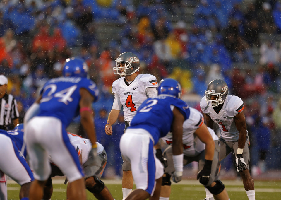 Oklahoma State's J.W. Walsh (4) stands behind the line of scrimmage during the college football game between Oklahoma State University (OSU) and the University of Kansas (KU) at Memorial Stadium in Lawrence, Kan., Saturday, Oct. 13, 2012. Photo by Sarah Phipps, The Oklahoman