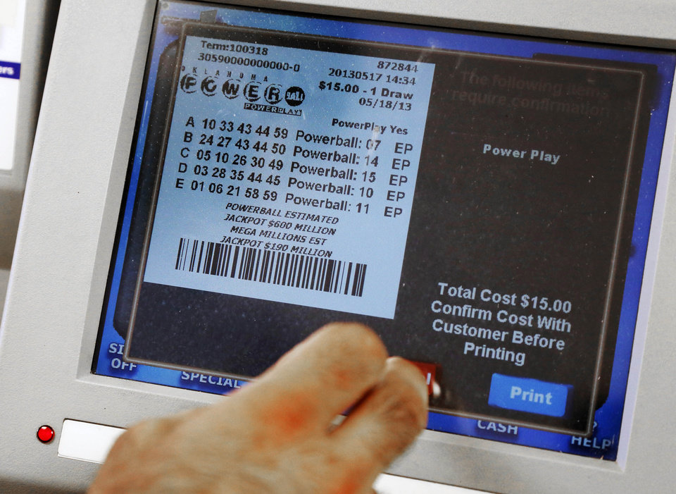 Photo - A clerk dispenses a Powerball Lottery ticket in Oklahoma City, Friday, May 17, 2013. Powerball officials say the jackpot has climbed to an estimated $600 million, making it the largest prize in the game's history and the world's second largest lottery prize.(AP Photo/Sue Ogrocki)
