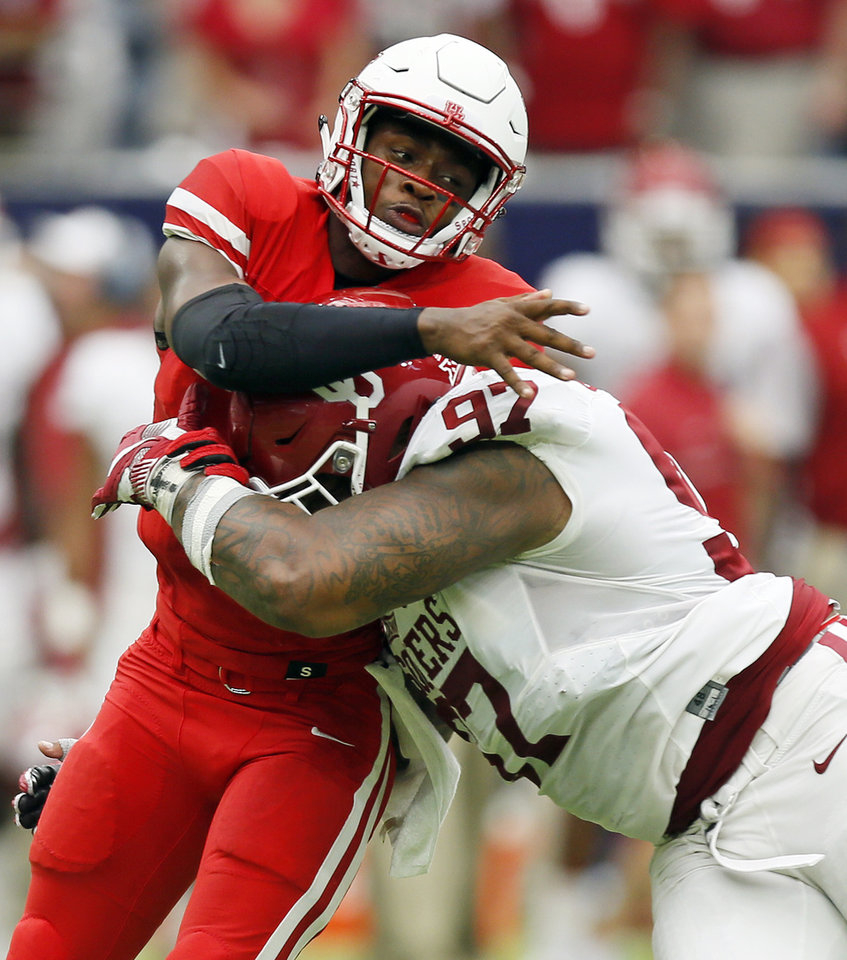 Photo - Oklahoma's Charles Walker (97) pressures Houston's Greg Ward Jr. (1) during the AdvoCare Texas Kickoff college football game between the University of Oklahoma Sooners (OU) and the Houston Cougars at NRG Stadium in Houston, Saturday, Sept. 3, 2016. Photo by Nate Billings, The Oklahoman