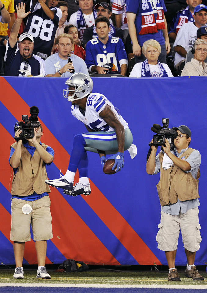 Photo -   Fans watch as Dallas Cowboys wide receiver Kevin Ogletree celebrates scoring a touchdown during the second half of an NFL football game against the New York Giants, Wednesday, Sept. 5, 2012, in East Rutherford, N.J. (AP Photo/Bill Kostroun)