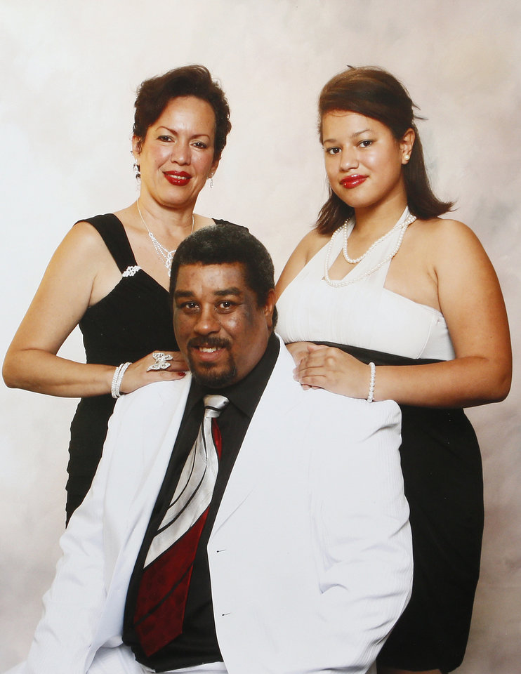 Photo - An undated family photo of Nair Rodriguez, left, Luinahi Rodriguez, right, and Luis Rodriguez, seated. Luis Rodriguez died during an incident with Moore police at the Warren Theatre, Friday, Feb. 14, 2014. Photo provided by the Rodriguez family.