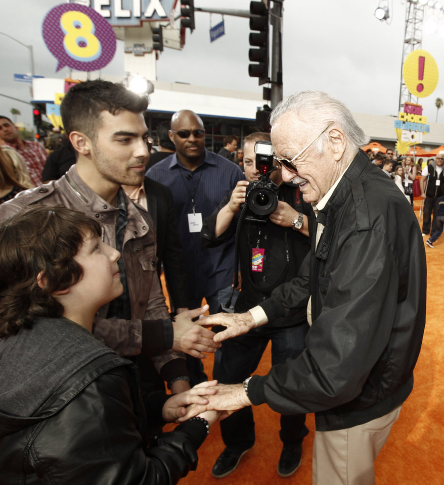 Photo - Frankie Jonas, left, and Joe Jonas, center, talk with Stan Lee at Nickelodeon's 24th Annual Kids' Choice Awards on Saturday, April 2, 2011, in Los Angeles.  (AP Photo/Matt Sayles)