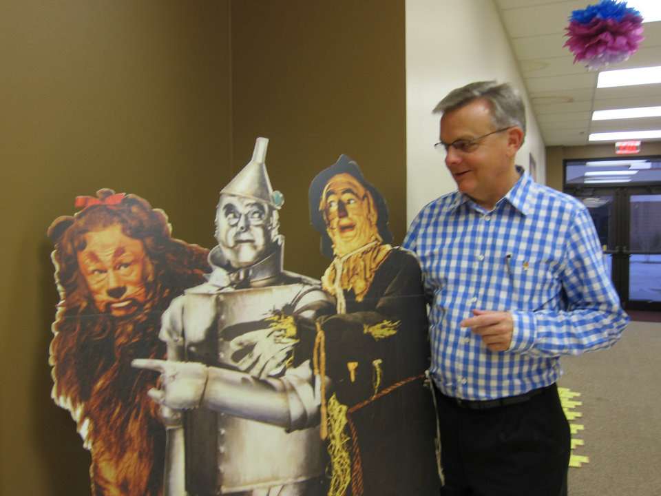 """Photo -  The Rev. Nathan Castle, pastor of the Catholic Community at Stanford, part of the Diocese of San Jose, Calif., poses for a picture with pop-up images of the Cowardly Lion, Tin Man and Scarecrow from """"The Wizard of Oz"""" on display in the hallway at St. Andrew Catholic Church in Moore. Photo by Carla Hinton, The Oklahoman"""