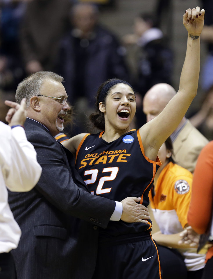 Oklahoma State guard Brittney Martin celebrates as she is hugged by head coach Jim Littell after winning a women's second round NCAA tournament college basketball game against Purdue in West Lafayette, Ind., Monday.  (AP Photo/Michael Conroy)