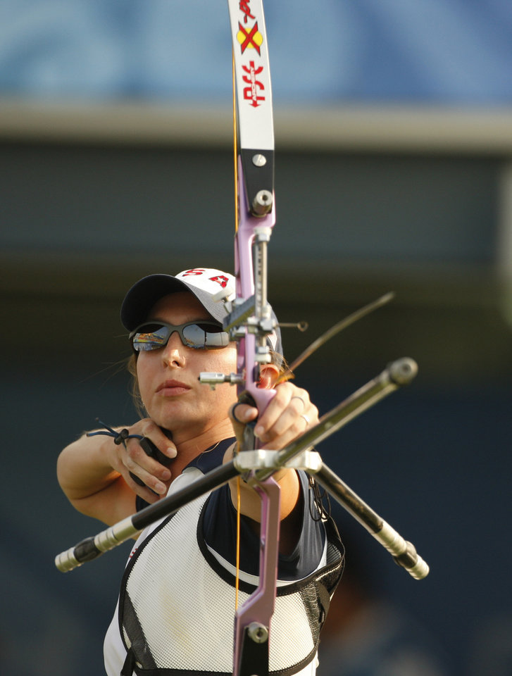 """Photo -   FILE - This Aug. 12, 2008 file photo shows Jennifer Nichols shooting an arrow during the elimination round of women's individual archery at the Beijing 2008 Olympics in Beijing. Nichols' eyes light up with she talks about her sport finally climbing out of the shadows. """"The Hunger Games"""" has shined a bright light on the ancient sport of archery and fueled interest across the country to pick up a bow and arrow. (AP Photo/Saurabh Das, File )"""